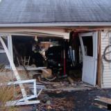 Car through a house