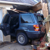 Car through a house