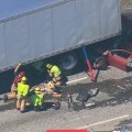 Car Pinned Under Box Truck